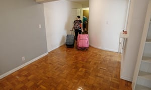Olivia Boren leaves her apartment for the last time as she and her husband Chris Dooly are moving out of New York City amid the coronavirus pandemic, on 26 May 2020.