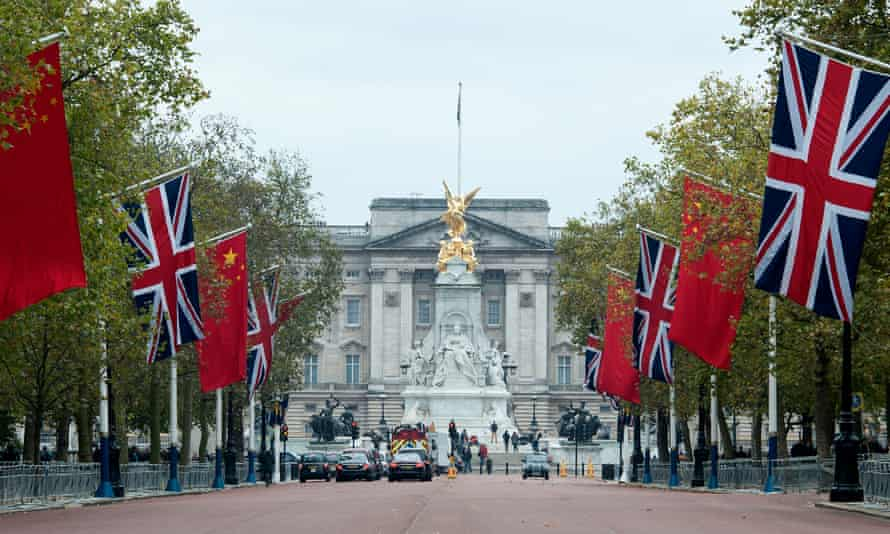 Chinese flags fly side by side with union flags on the Mall ahead of Xi Jinping's state visit.