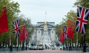 Preparations begin for the Chinese State visit, with Chinese and UK flags lining the Mall leading to Buckingham Palace in London.