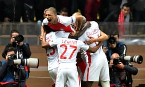 The Monaco players celebrate their second goal.