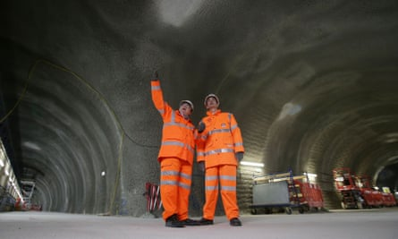 Two men inspect the Crossrail tunnels