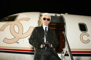 Lagerfeld poses next to a Chanel jet after the 2007/08 Chanel Cruise Show, which was presented at the Santa Monica Airport, California