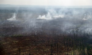 An aerial view of a forest fire in Boguchar District