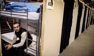 Mohamad, a refugee, sitting at his bunkbed at the refugee tent camp in Naestved, Denmark