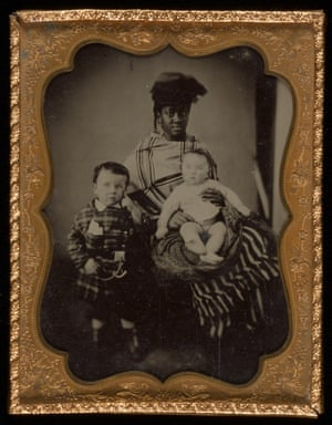 African American nanny with two young boys, late 19th century