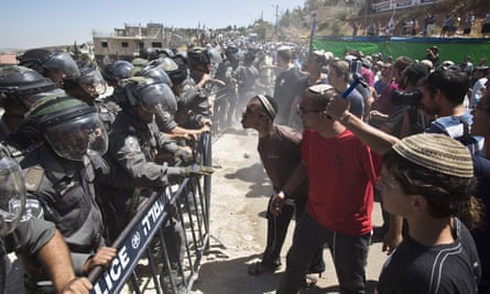 Israeli police block Jewish settlers protesting against the demolition of two buildings in Beit El in the occupied West Bank on Wednesday.