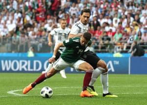 Javier Hernandez goes down under pressure from Mats Hummels.