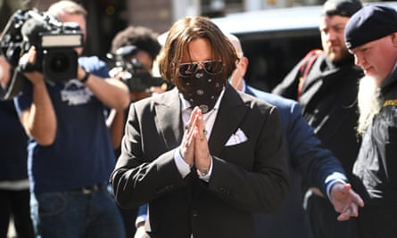 Johnny Depp arrives at court on Friday for the libel trial hearing against the Sun.