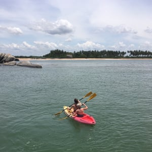 Liz and Laura take a kayak to the beach