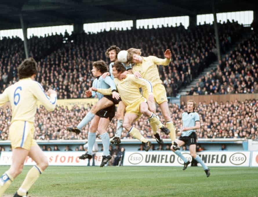 Gordon McQueen, pictured heading the ball for Leeds against Coventry in 1976, was revered for his bravery in the air.