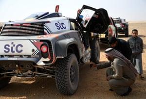 Stage 7 Hail - Sakaka  Fans admire the car of X-Raid Mini JCW Team's Stephane Peterhansel and co-driver Edouard Boulanger