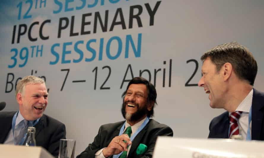Jochen Flasbarth, State Secretary of the German Enviroment Ministry, Rejendra K. Pachauri, Chairman of the IPCC, and Jochen Schuette, State Secretary of the German Sience Ministry, from left, share a light moment prior to a meeting of the Intergovernmental Panel on Climate Change, IPCC, in Berlin, Germany, Monday, April 7, 2014.