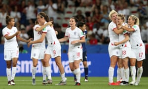 Ellen White of England (second right) celebrates with teammates after scoring her team's second goal.