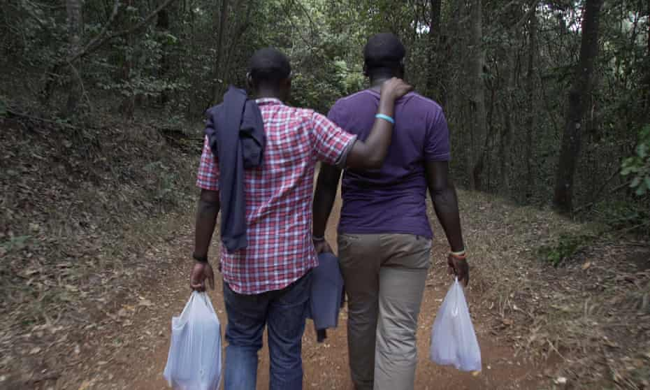 Samuel and Alex walk in the Karura Forest during the filming of I am Samuel