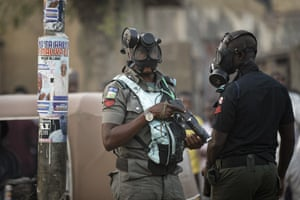 Kano, NigeriaRiot policeman wear gas masks and carry a tear gas grenade launcher, but did not fire, during a celebratory gathering of supporters of President Muhammadu Buhari anticipating victory. Nigeria's electoral commission on Monday began announcing official results from the country's 36 states as President Muhammadu Buhari seeks a second term