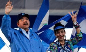 Nicaraguan president Daniel Ortega and his wife and vice-president Rosario Murillo, wave to supporters Wednesday during a rally in Managua, Nicaragua.
