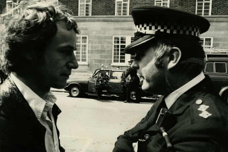 Duncan Campbell and a police officer at a demo in the 80s