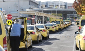 Taxis line up at Melbourne Tullamarine airport to collect passengers.