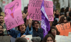 Pakistani civil society activists carry placard and shout slogans during a rally for women rights on International Women's Day in Islamabad on March 8