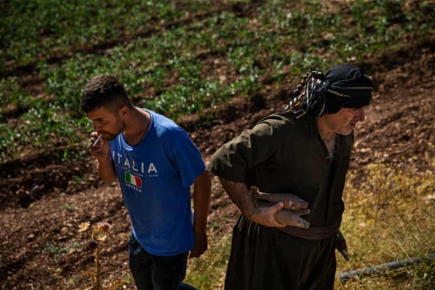 Farmer Peshawa Hares, right, and Rizgar Ali after they removed mortar shells hidden under a shrub on Hares' property at Serdera Village near Penjwen, Iraqi Kurdistan