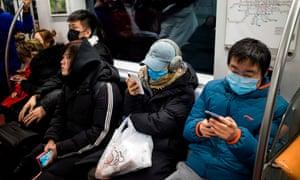 Subway passengers wear protective masks in Beijing