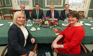 Michelle O'Neill (left) and Arlene Foster pose for a photograph during Boris Johnson's visit to Stormont in January. Photograph: Liam McBurney/Reuters