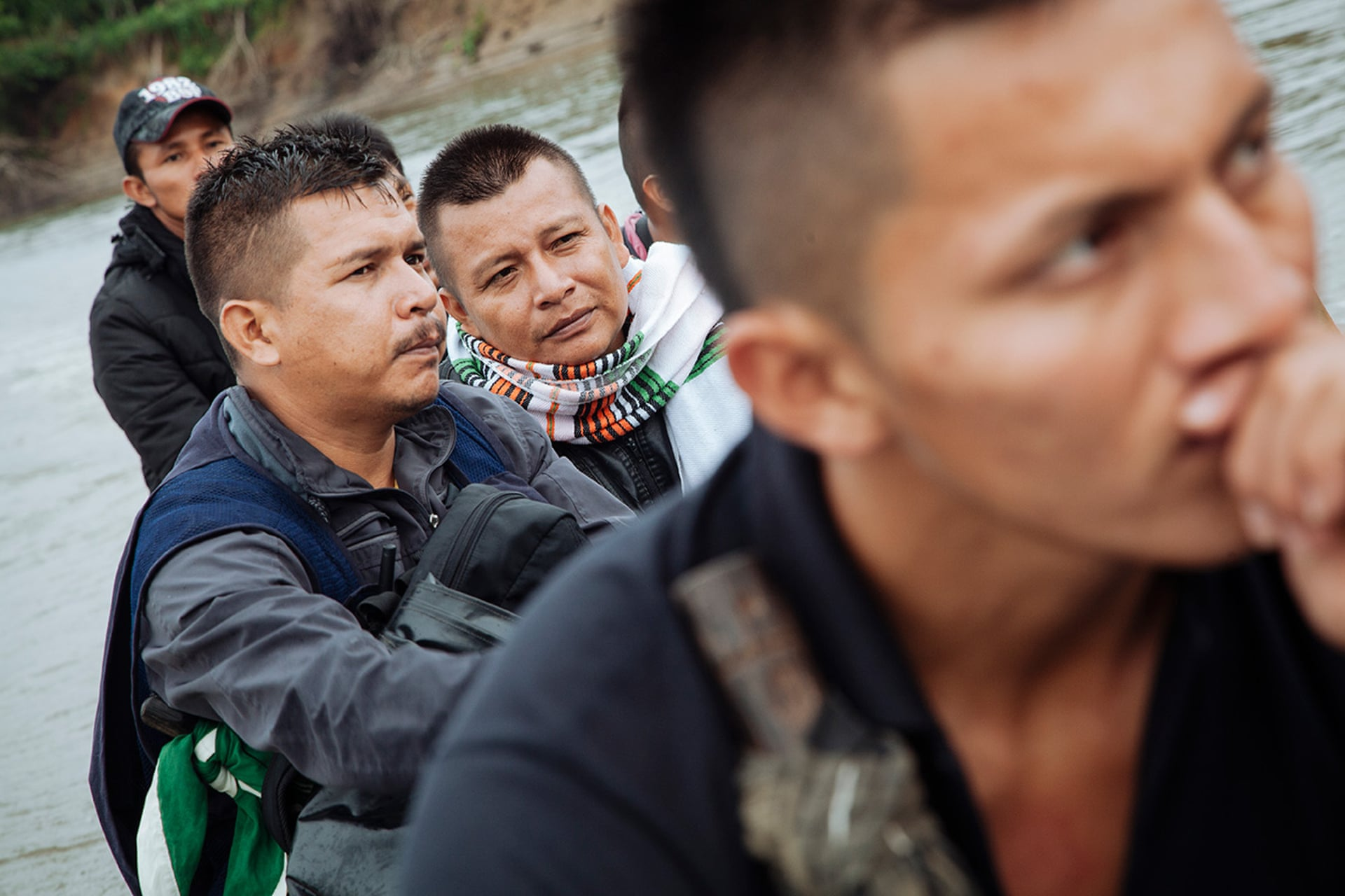 Mario, Sandro and members of Buenavista's guardia travelling by motorised canoe on the River Putumayo. Photograph: Mateo Barriga Salazar