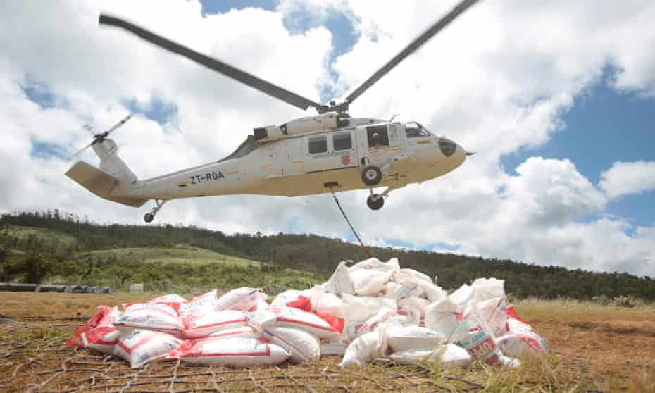 Aid supplies for people affected by Cyclone Idai are airlifted by helicopter for distribution near Chipinge, Zimbabwe
