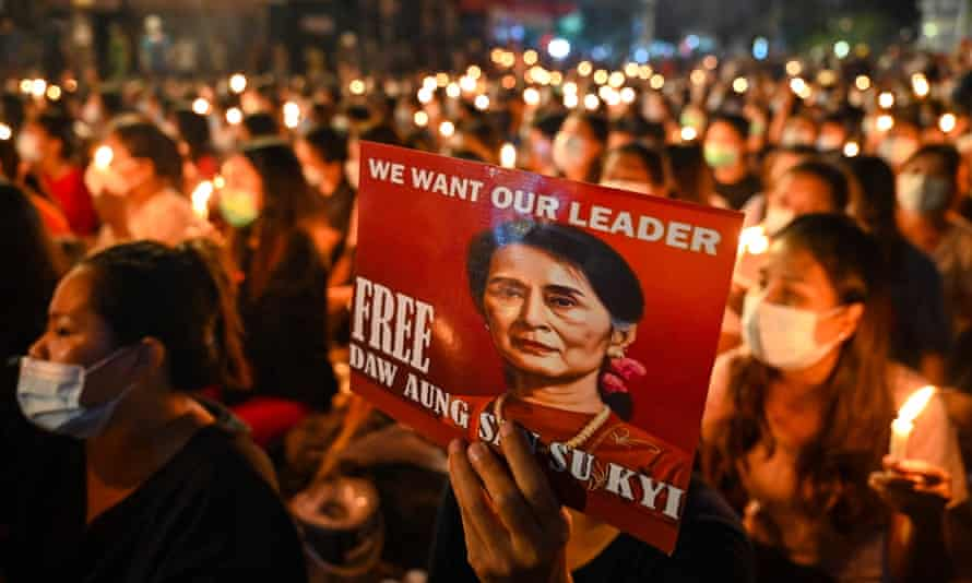 Protesters in Yangon call for the release of Aung San Suu Kyi. A businessman close to Myanmar's military regime has alleged she accepted huge bribes in cash.