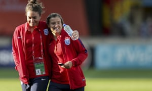 Jodie Taylor and Fran Kirby smile on the pitch before Lionesses' victory over France on Sunday