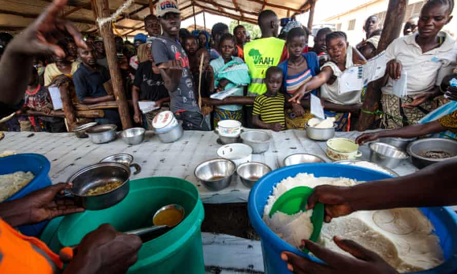 Refugees from the DRC are fed at the Kagoma reception centre within the Kyangwali settlement.