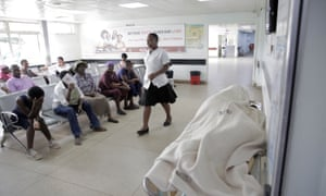 Patients wait to be treated in the casualty ward at Parirenyatwa Hospital in Harare, 27 December, after the government suspended hundreds of doctors who had gone on strike.