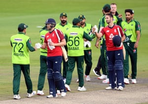 Malan and Gregory pump fists with the Pakistan players after England's win.