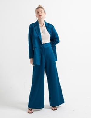 model wears blazer, £100, and trousers, £80, asos.com. Polo top, £29.99, hm.com. Sandals, £99, kurtgeiger.com. Hoops, £42, luvaj.com