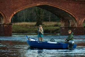 The celebrity angler Marina Gibson casts a line, watched by the head gillie Calum Robertson