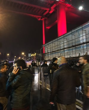 Turkish police seal off the road outside the Reina nightclub in Istanbul, where dozens of people have been killed by an armed attacker.