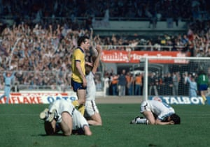 West Ham United players including Paul Allen (right) fall to their knees in celebration after the 1980 FA Cup Final between West Ham United and Arsenal