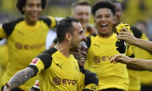 Dortmund's Paco Alcácer celebrates after he scored the winning goal against Augsburg.