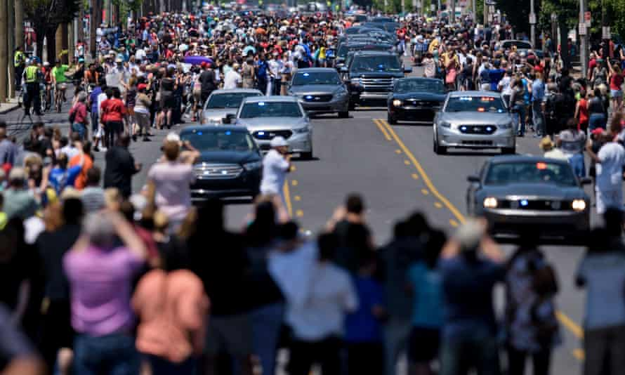 People watch a burial procession with the remains of boxing legend Muhammad Ali as it travels to Cave Hill cemetery on Friday in Louisville.