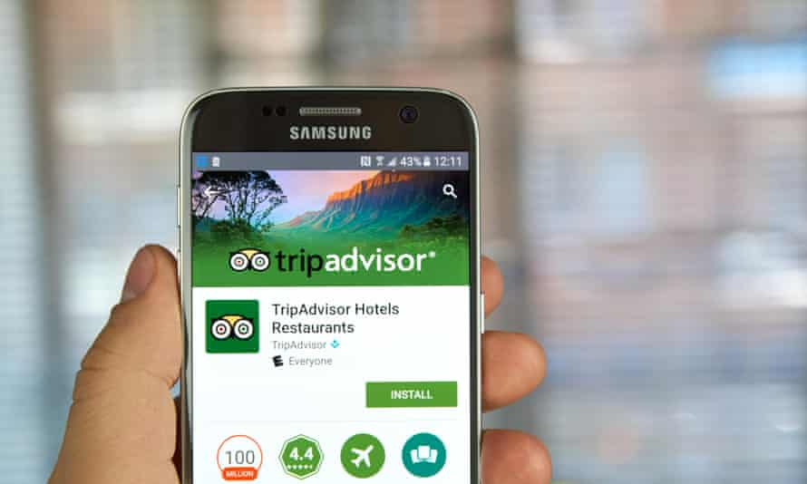 TripAdvisor app on phone screen.