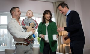 David Cameron and his wife Samantha meeting first time home buyer Robert Arron (left) and his son Finlay at the Heritage Brook housing development in Chorley, Lancashire this morning