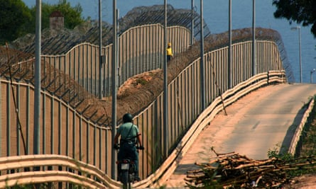 Spanish Civil Guard patrols the barrier which separates Melilla from Morocco