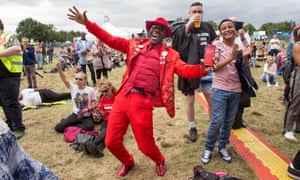 Labour party supporters join in the festivities at the Labour Live event, held at the White Hart Lane Recreation Ground in north London.