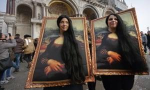 Reflecting ourselves: revellers masquerade as Leonardo da Vinci's Mona Lisa in Venice.