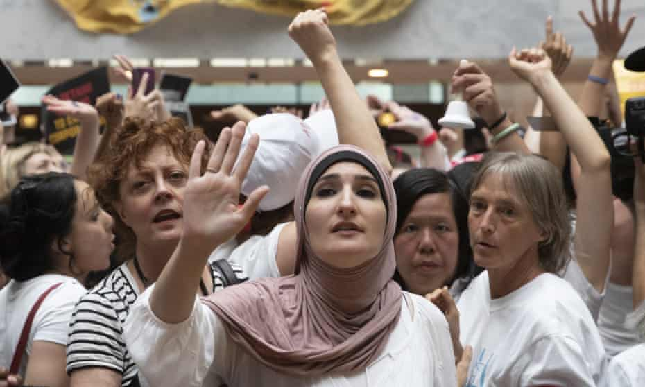 On Capitol Hill Thursday, hundreds of activists, including actress Susan Sarandon, center left, and Linda Sarsour (center) challenged the separation of families.