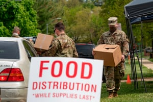 Soldiers with the Maryland Army National Guard distribute food to those in need in Windsor Mill, Maryland.