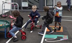 Children play in a school in London