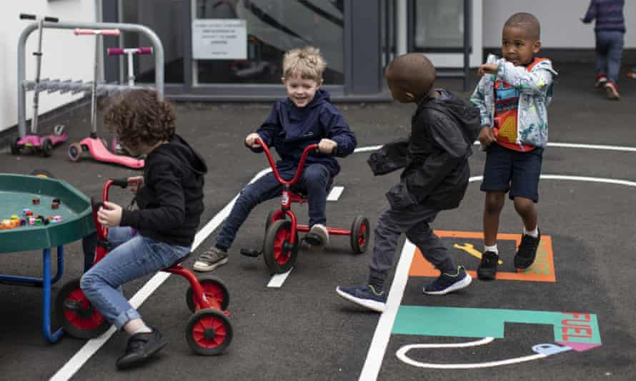 Children play in a school in London