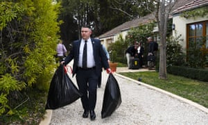 Australian federal police officers raid the home of Cameron Jon Gill on 4 September.