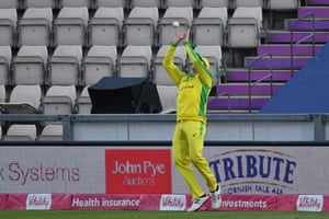Smith takes a catch on the boundary to take the wicket of Ali.